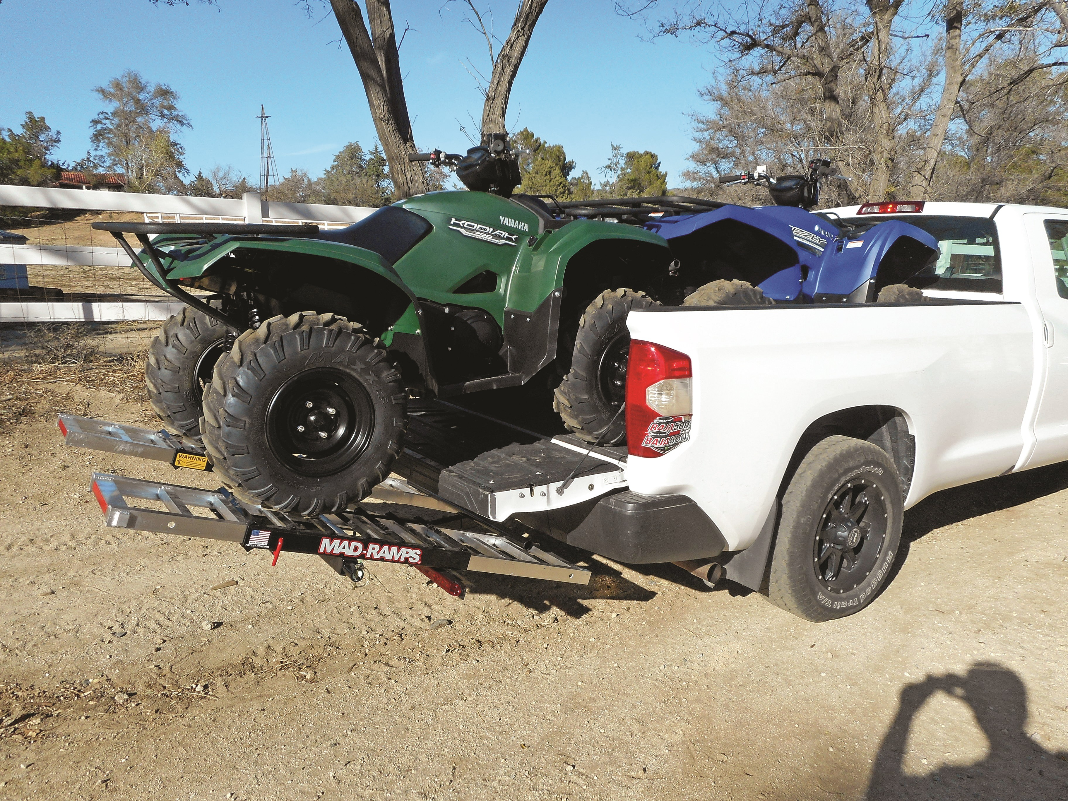 Chevy Silverado transports two ATVs with MAD-RAMPS