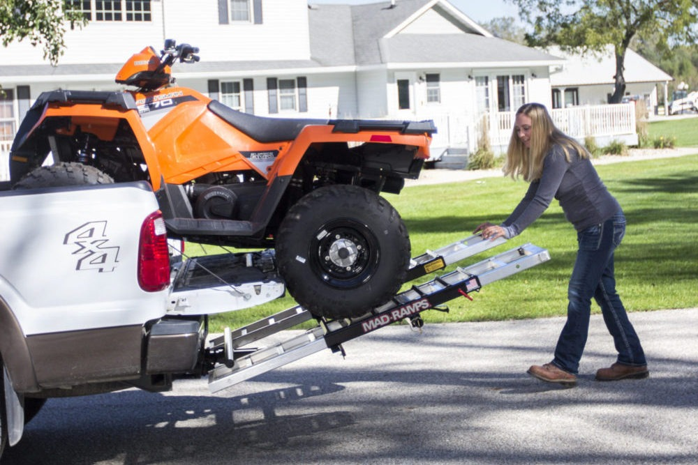 Woman loads ATV onto her truck with MAD-RAMPS pivoting ramp system