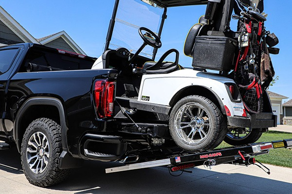 Golf Cart being loaded onto a truck bed with MadRamps