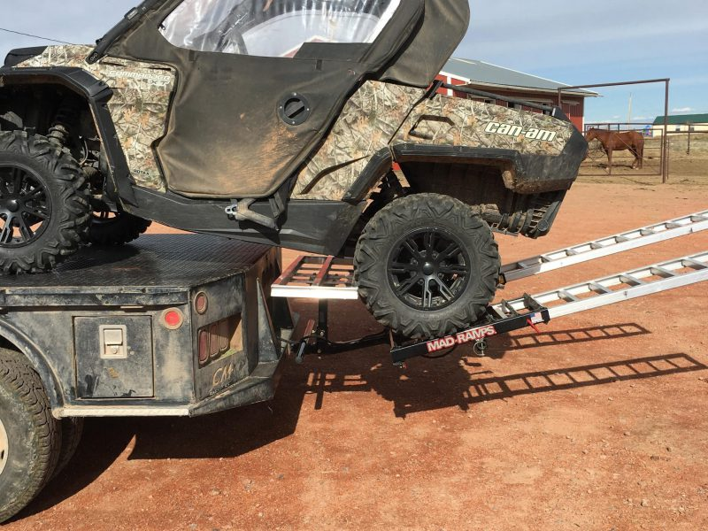 utv loaded on flatbed truck with madramps
