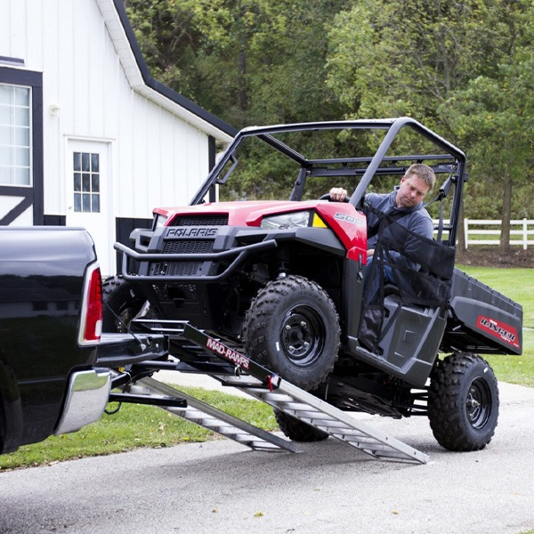 Farmer loading is ATV into his truck