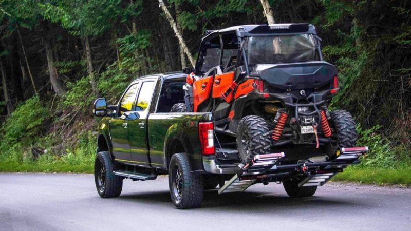 four passenger UTV loaded on a truck bed with MADRAMPS in drive position